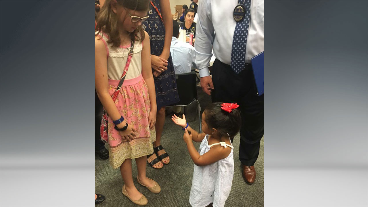 Touching moment between daughters of fallen officers